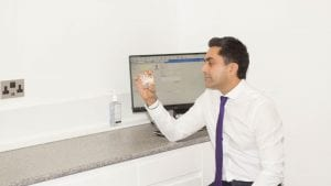 Wolverhampton Dentist Dr Dehal looking at invisalign dental brace and orthodontics models