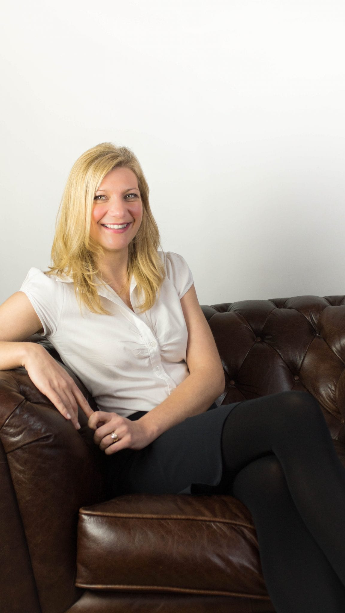 Dawn Everitt sitting in waiting room at Rock House Dental Practice